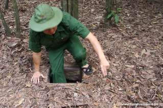 A trap door on the jungle floor leads down into the Cu Chi tunnels