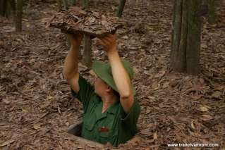 Cu Chi Tunnels - Getting down small secret entrance