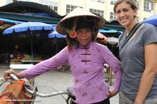 A foreign tourist with a local woman