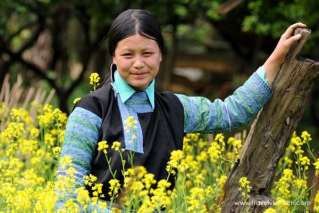 An ethnic girl among flowers