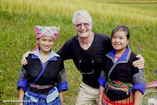 A foreign tourist and local children