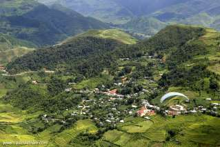 A small village embraced by green