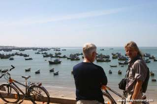 Foreign tourists biking along Mui Ne fishing village