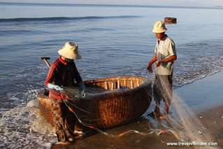 Fishermen collecting fresh fish