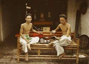 Tonkin, Hanoi, Two opium-smokers drinking tea, 1915.