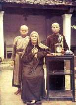 n the picture are a nun and two novices beside a prayer-book, a clock and a lily vase