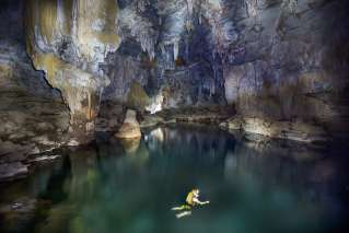 An expert explore the lake inside the cave